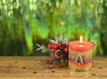 Christmas candle with decor 1. Colorful Christmas candle with decorations on blurred background Stock Photo