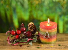 Christmas candle with decor 2. Christmas candle with decoration on blurred background Royalty Free Stock Photography