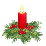 Christmas candle. Decorated with fir branches and berries Royalty Free Stock Photography