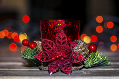 Christmas candle for decoration on a bokeh background. Red christmas candle for home decoration royalty free stock image
