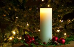 Christmas candle and decorations. Royalty Free Stock Photos