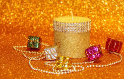 Christmas candle and decorative box. On gold background Royalty Free Stock Photos