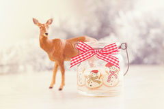 Christmas candle and deer. Christmas candle with deer pastel toned image Stock Images