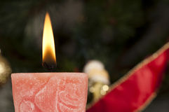 Christmas candle on the festive table Royalty Free Stock Photos