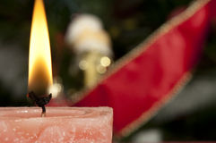 Christmas candle on the festive table Stock Photography