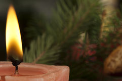 Christmas candle on the festive table Royalty Free Stock Photo