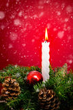 Christmas candle and fir branches Royalty Free Stock Photo