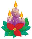 Christmas candle with flower Stock Photo