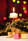 Christmas candle and gift boxes. Royalty Free Stock Photography