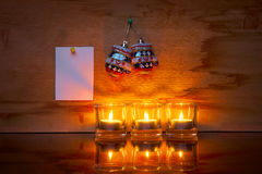 Christmas candle with a gift and a sticker Royalty Free Stock Photos