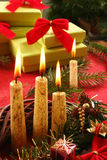 Christmas candle and gifts. Still life with candle and gifts Stock Image