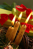 Christmas candle and gifts Royalty Free Stock Images