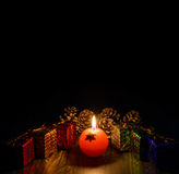 Christmas candle with gifts Royalty Free Stock Photo