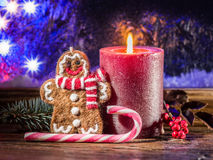 Christmas candle, ginger man toy and candy canes. Stock Images