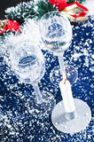 Christmas candle and glasses Stock Photography