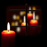 Christmas candle glow Stock Images