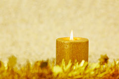 Christmas candle with golden background Stock Photo