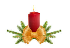 Christmas candle with golden bow Stock Photos