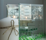 Christmas candle and green tinsel with sequins. The deer on the glass background Stock Photo