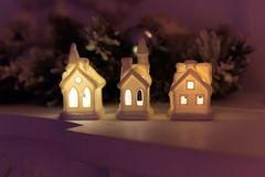 Christmas candle holder in the form of a house. Christmas scene with three trees and a little candle holder in the form of a house Stock Image