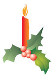 Christmas candle with holly Stock Photo