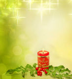 Christmas candle and holly background Royalty Free Stock Photography