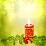 Christmas candle and holly background Royalty Free Stock Photo