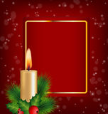 Christmas Candle, holly, pine and frame on red Royalty Free Stock Photography