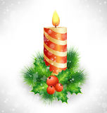 Christmas candle with holly and pine on grayscale. Burning Christmas candle with holly sprigs and pine branches in snowfall on grayscale background Royalty Free Stock Image