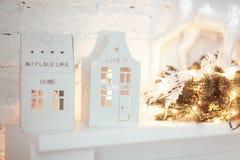 Christmas candle houses. Burning lantern and xmas decoration on white background.  Stock Images