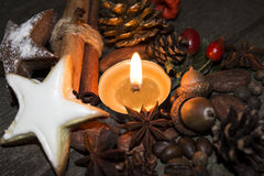 Christmas candle. A candle is an ignitable wick embedded in wax or another flammable solid substance such as tallow that provides light, and in some cases, a Royalty Free Stock Image