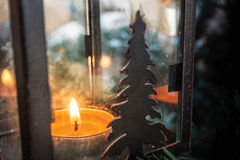 Christmas Candle. In a lamp on Christmas tree Stock Images