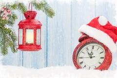 Christmas candle lantern and alarm clock Stock Photography