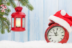 Christmas candle lantern and alarm clock Royalty Free Stock Photography