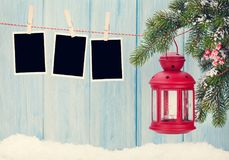 Christmas candle lantern and photo frames Royalty Free Stock Images
