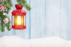 Christmas candle lantern on fir tree branch Royalty Free Stock Photos