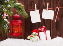 Christmas candle lantern, gift box and photos Stock Images
