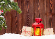 Christmas candle lantern and gift boxes Royalty Free Stock Photos