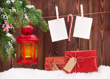 Christmas candle lantern and photo frames Stock Photography