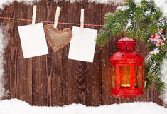 Christmas candle lantern and photo frames Stock Photos
