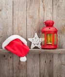 Christmas candle lantern, santa hat and decor Royalty Free Stock Photos