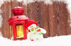 Christmas candle lantern and snowman toy Royalty Free Stock Images