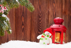 Christmas candle lantern and snowman Royalty Free Stock Photography