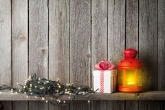 Christmas candle lantern, xmas lights and gift box Stock Image