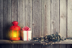 Christmas candle lantern, xmas lights and gift box Royalty Free Stock Image