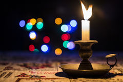 Christmas candle and light Stock Images