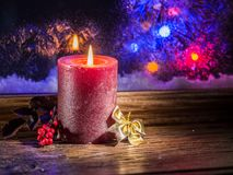 Christmas candle light and frozen window. Christmas background Royalty Free Stock Photos