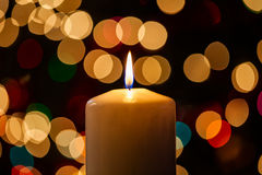 Christmas Candle and Lights Royalty Free Stock Photography