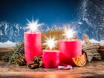 Christmas candle lights and frozen window. Royalty Free Stock Photos
