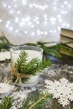 Christmas candle. Magic christmas mood with burning candle and glittering christmas tree lights stock images